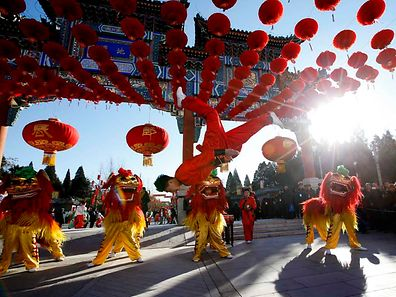 Traditional dancers perform lion dance during the opening of the temple fair for the Chinese New Year celebrations at Ditan Park, also known as the Temple of Earth, in Beijing February 18, 2015.