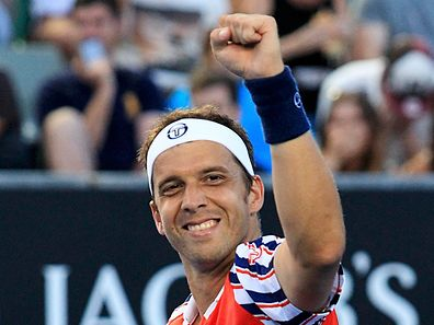 Gilles Muller of Luxembourg celebrates after defeating John Isner of the U.S. during their men's singles third round match at the Australian Open 2015 tennis tournament in Melbourne