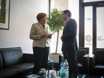 Angela Merkel and Alexis Tsipras speak in Brussels on April 23