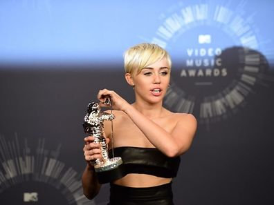 Recording artist Miley Cyrus poses in the press room during the MTV Video Music Awards (VMA), August 24, 2014 at the Nokia Theatre in downtown Los Angeles