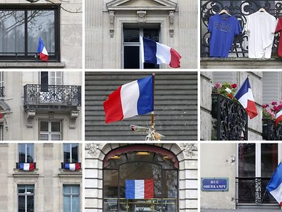 A combination of pictures shows French flags seen on windows and facades of buildings in Paris, France