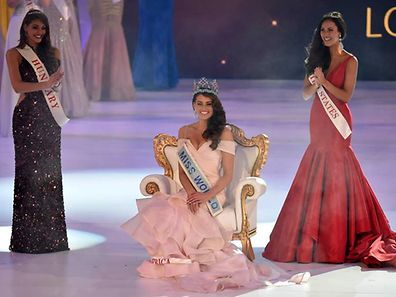 Rolene Strauss of South Africa (C) is crowned Miss World 2014, as Elizabeth Safrit of the U.S (R) and Edina Kulczar of Hungary (L) who placed third and second respectively, look on