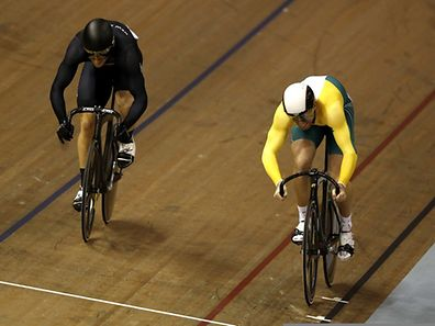 Australia's  Peter Lewis (R) and New Zealand's Matthew Archibald  compete in the men's sprint quarter final