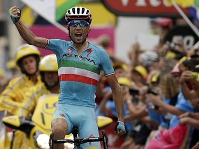 Italy's Vincenzo Nibali celebrates as he crosses the finish line at the end of the 138 km nineteenth stage of the 102nd edition of the Tour de France cycling race