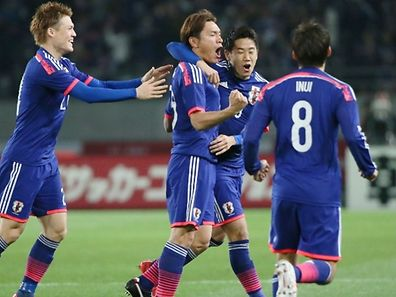 Japan's midfielder Toshihiro Aoyama (C) celebrates with teammates after he scored a goal against Uzbekistan during the first half of the football international friendly match in Tokyo on March 31, 2015. Japan lead 1-0 after the first half.   AFP PHOTO / JIJI PRESS    JAPAN OUT