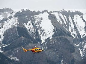 A helicopter of the French civil security services flies near Seyne, south-eastern France, on March 24, 2015, near the site where a Germanwings Airbus A320 crashed in the French Alps. A German airliner crashed near a ski resort in the French Alps on March 24, killing all 150 people on board, in the worst plane disaster in mainland France in four decades.. AFP PHOTO / ANNE-CHRISTINE POUJOULAT
