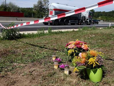Flowers and candles at the site where the truck was found