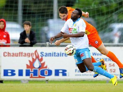 FOOT FC RODANGE 91 - TITUS LAMADELAINE. Henid Ramdedovic, Djalo Bacari.  Samedi 23 Aout 2014. � NICOLAS BOUVY/Tout droit reserve.