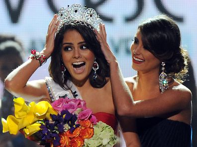 "(FILES) Miss Mexico Jimena Navarrete (L) celebrates after being crowned Miss Universe by Miss Universe 2009 Stefania Fernandez (R) of Venezuela during the Miss Universe 2010 Pageant Final at the Mandalay Bay Hotel in Las Vegas on August 23, 2010. Mexico on June 30, 2015 announced that has dropped out of the Miss Universe pageant over co-owner and US presidential candidate Donald Trump's ""racist"" remarks about Mexican migrants, as Latino anger toward the outspoken tycoon boils over.      AFP PHOTO/Mark RALSTON"