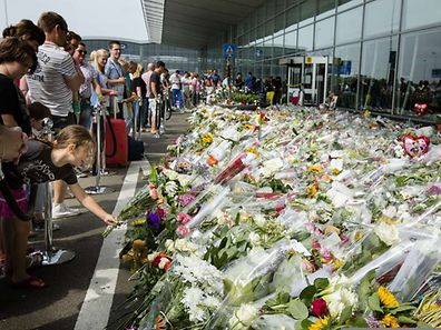 Flowers placed in memory of the victims of the Malaysia Airlines flight MH17 at Schiphol airport, near Amsterdam