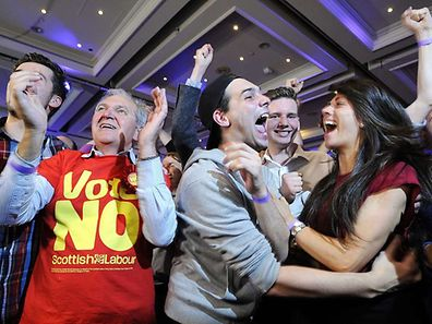 Pro-union supporters celebrate as Scottish independence referendum results are announced at a 'Better Together' event in Glasgow,