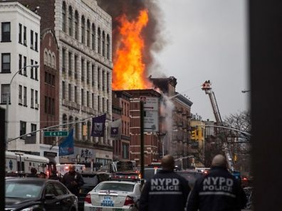 NEW YORK, NY - MARCH 26: A building burns after an explosion on 2nd Avenue on March 26, 2015 in New York City. The seven alarm fire drew firefighters from across the city. A number of injuries have been reported.   Andrew Burton/Getty Images/AFP == FOR NEWSPAPERS, INTERNET, TELCOS & TELEVISION USE ONLY ==