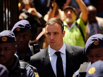 South African Olympic and Paralympic sprinter Oscar Pistorius leaves the North Gauteng High Court in Pretoria, October 17,