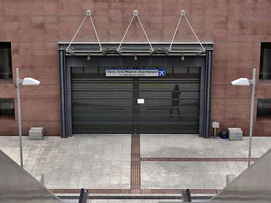 The shut entrance of a metro station in Athens during a 24-hour general strike on November 27