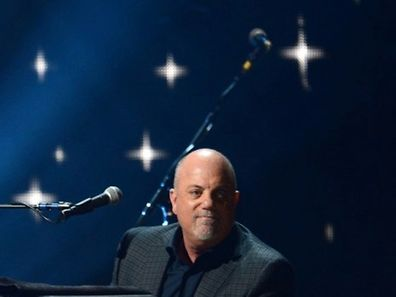 Billy Joel on stage at Madison Square Garden in New York.  DON EMMERT