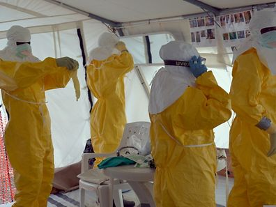 Liberian health workers don full protection outfits at a Doctors Without Borders Ebola treatment center in Monrovia