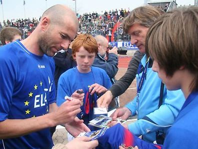Zidane signs autographs at Stade Josy Barthel in Luxembourg in 2010. He will return to the Grand Duchy for a charity game on July 3