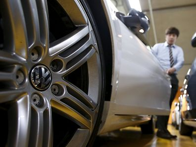A Volkswagen's logo is seen on a wheel of a car at a used car dealership in Seoul, South Korea, October 2, 2015. German carmaker Volkswagen , rocked by a diesel emissions scandal that erupted on Sept 18, saw its sales in South Korea slide 7.8 percent in September from a month earlier, according to industry data released on Tuesday. Picture taken October 2, 2015. REUTERS/Kim Hong-Ji
