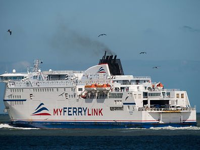 Ferry boat Rodin of the company My Ferry Link leaving the Calais harbour, northern France.