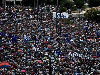 Pro-European Union protester demonstrate in front of the parliament in Athens on June 30