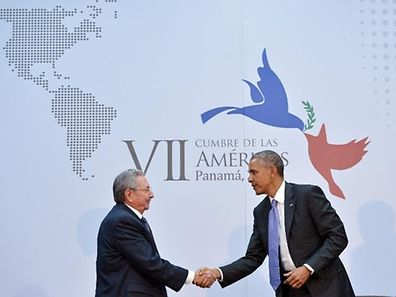President Barack Obama shakes hands with Cuba's President Raul Castro