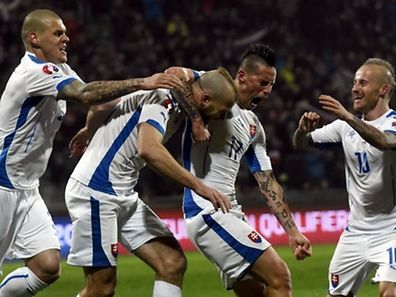 (L-R) Martin Skrtel, Adam Nemec, Marek Hamsik and Miroslav Stoch of Slovakia celebrate their first goal against Luxembourg during their Euro 2016 qualifying soccer match at the MSK stadium in Zilina March 27, 2015. REUTERS/Radovan Stoklasa