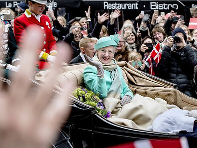Denmark's Queen Margrethe waves on her 75th birthday in an open carriage travelling from Amalienborg to Copenhagen City Hall, in Stroeget April 16, 2015. ATTENTION EDITORS - THIS IMAGE WAS PROVIDED BY A THIRD PARTY. THIS PICTURE IS DISTRIBUTED EXACTLY AS RECEIVED BY REUTERS, AS A SERVICE TO CLIENTS. FOR EDITORIAL USE ONLY. NOT FOR SALE FOR MARKETING OR ADVERTISING CAMPAIGNS. DENMARK OUT. NO COMMERCIAL OR EDITORIAL SALES IN DENMARK. NO COMMERCIAL SALES.