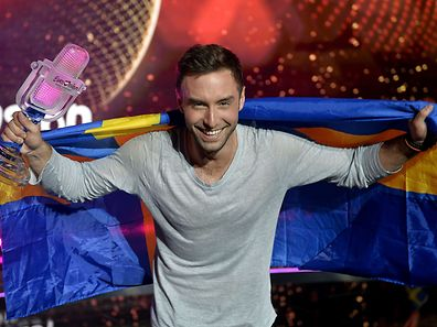Sweden's Mans Zelmerlow reacts after winning the Eurovision Song Contest final on May 23, 2015 in Vienna.   AFP PHOTO / SAMUEL KUBANI