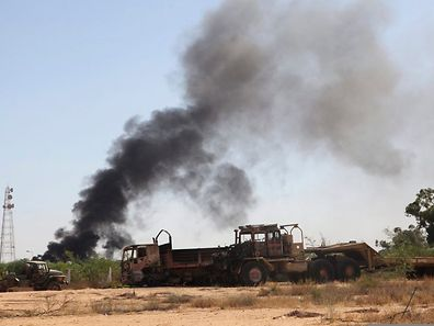 Smoke rises from the Brigade Qaqaa headquarters, a former Libyan Army camp known as Camp 7 April, following clashes between rival militias at the Sawani road district