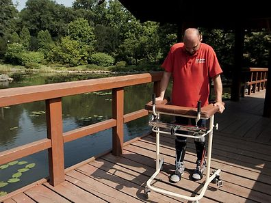 Bulgarian man Darek Fidyka walks with the aid of leg-braces and a walking frame at the Akron Neuro-Rehabilitation Centre in Wroclaw, Poland