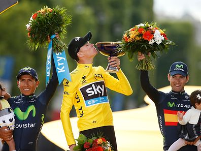 Team Sky rider Chris Froome of Britain (C), the race leader's yellow jersey, celebrates his overall victory on the podium with second placed Movistar rider Nairo Quintana of Colombia (L) and third placed Movistar rider Alejandro Valverde of Spain after the 109.5-km (68 miles) final 21st stage of the 102nd Tour de France cycling race from Sevres to Paris Champs-Elysees, France, July 26, 2015.   REUTERS/Benoit Tessier
