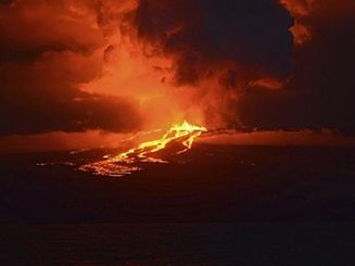 The Wolf volcano spews smoke and lava on Isabela Island, in this May 25, 2015 handout photograph provided by the Galapagos National Park. A volcano perched atop one of Ecuador's Galapagos Islands erupted in the early hours of Monday, the local authorities said, potentially threatening a unique species of pink iguanas. The roughly 1.7-kilometer (1.1-mile) high Wolf volcano is located on Isabela Island, home to a rich variety of flora and fauna typical of the archipelago that helped inspire Charles Darwin's theory of evolution following his 1835 visit. REUTERS/Galapagos National Park/Diego Paredes/Handout via Reuters  ATTENTION EDITORS - FOR EDITORIAL USE ONLY. NOT FOR SALE FOR MARKETING OR ADVERTISING CAMPAIGNS. THIS PICTURE WAS PROVIDED BY A THIRD PARTY. REUTERS IS UNABLE TO INDEPENDENTLY VERIFY THE AUTHENTICITY, CONTENT, LOCATION OR DATE OF THIS IMAGE. THIS PICTURE IS DISTRIBUTED EXACTLY AS RECEIVED BY REUTERS, AS A SERVICE TO CLIENTS. MANDATORY CREDIT.