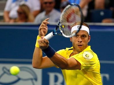 Gilles Muller of Luxembourg returns a forehand to Marcos Baghdatis of Cyrpus during the BB&T Atlanta Open at Atlantic Station on August 1, 2015 in Atlanta, Georgia.