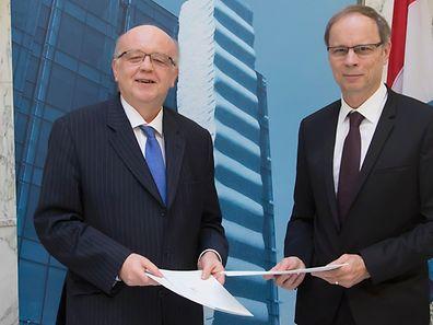 Gaston Reinesch, gouverneur de la Banque centrale du Luxembourg, et Jean Tirole, président de la Toulouse School of Economics, ont signé un accord de partenariat. (Photo: BCL)