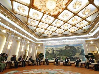 China's President Xi Jinping (4th R) meets with the guests at the Asian Infrastructure Investment Bank (AIIB) launch ceremony