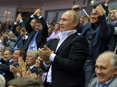 Russian President Vladimir Putin applauds on August 31, 2014 while attending the World Judo Championships in Chelyabinsk.