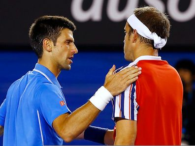 Novak Djokovic (l.) and Gilles Muller after their men's singles fourth round match at the Australian Open 2015