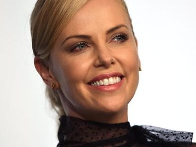 "South African-US actress Charlize Theron smiles during a press conference for the film ""Mad Max : Fury Road"" during the 68th Cannes Film Festival in Cannes, southeastern France, on May 14, 2015. AFP PHOTO / ANNE-CHRISTINE POUJOULAT"