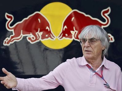Formula One supremo Bernie Ecclestone gestures in front of the Red Bull garage at the Buddh International Circuit in Greater Noida on the outskirts of New Delhi October 27, 2011. India hosts its maiden F1 race from October 28-30.     REUTERS/Altaf Hussain (INDIA - Tags: SPORT MOTORSPORT)