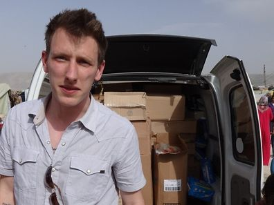 This Kassig Family released handout photo on October 4, 2014 shows Peter Kassig in front of a truck somewhere along the Syrian border between late 2012 and autumn 2013