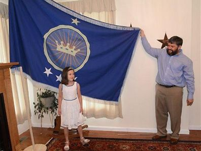 "Proud father and daughter showing off the ""Kingdom of North Sudan"" flag"