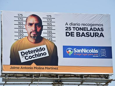 View of a billboard with a picture of a person arrested for littering in Monterrey, on July 29, 2015