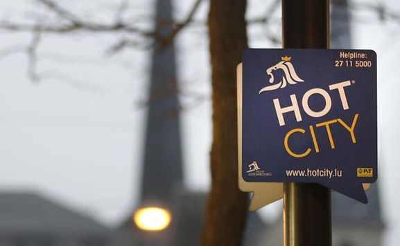 "Sign showing Luxembourg City's wifi system ""Hot City"""
