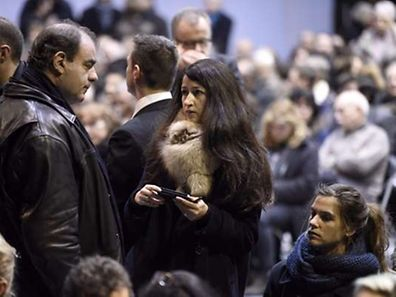 "(FILES) A file picture taken on January 16, 2015 in Pontoise shows Charlie Hebdo's journalist Zineb El Rhazoui (C) attending the funeral ceremony of French cartoonist and Charlie Hebdo editor Stephane ""Charb"" Charbonnier. El Rhazoui was 