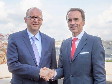 Hugues Delcourt (à dr.) succède à François Pauly (à g.) à la tête de la BIL.