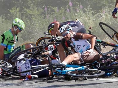 Riders and their bicycles fill the road after a fall during the 159,5 km (99 miles) third stage of the 102nd Tour de France cycling race from Anvers to Huy, Belgium, July 6, 2015. REUTERS/Eric Gaillard
