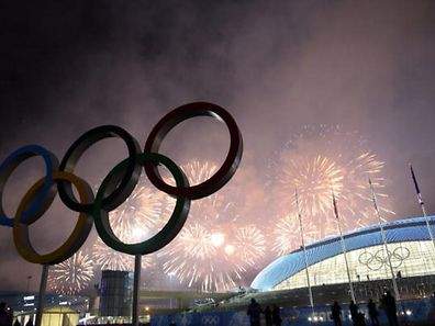 Fireworks explode over the Olympic park at the end of the Closing Ceremony of the Sochi Winter Olympics on February 23, 2014.