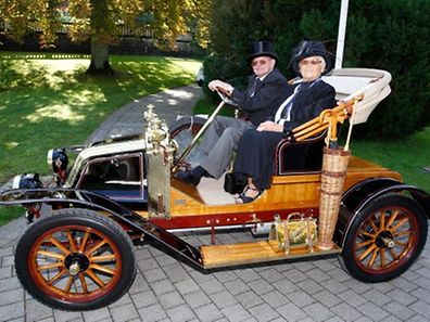 A couple sit inside a Renault AX 10 at a previous Make a Wish Concours d'Elegance