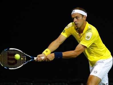 Gilles Muller of Luxembourg returns a backhand to Go Soeda of Japan during the BB&T Atlanta Open at Atlantic Station on July 31, 2015