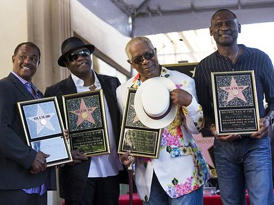 "Music group ""Kool & the Gang"", Ronald Bell, Robert ""Kool"" Bell, Dennis Thomas and George Brown (L-R) pose after unveiling their star on the Hollywood Walk of Fame in Los Angeles, California, October 8, 2015. REUTERS/Mario Anzuoni"
